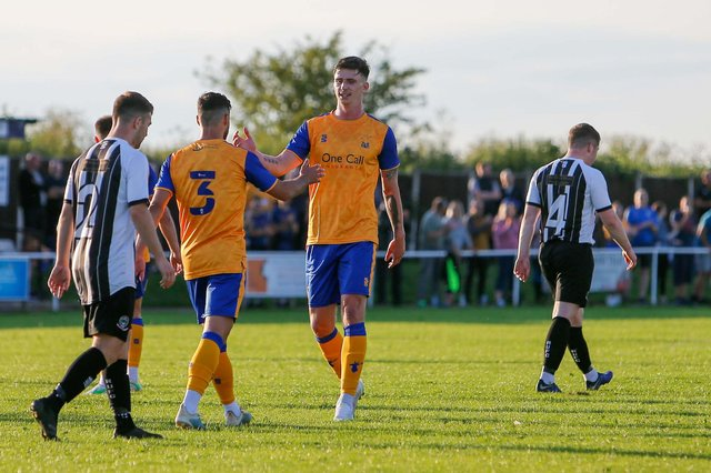Mansfield Town's Oliver Hawkins celebrates his opening goal.