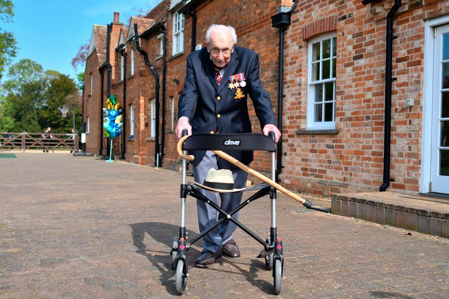 """British World War II veteran Captain Tom Moore completed 100 laps of his garden in a fundraising challenge for healthcare staff that has """"captured the heart of the nation"""", raising more than £13 million (Photo by JUSTIN TALLIS/AFP via Getty Images)"""