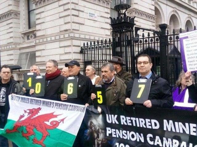 Former mineworkers campaigning outside Downing Street