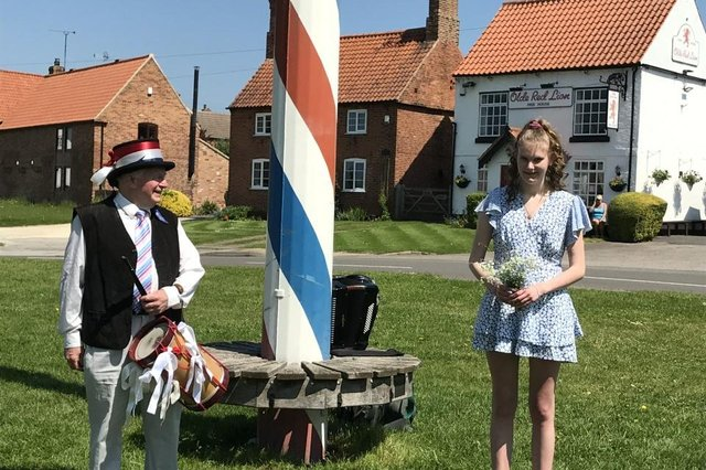 May Queen-elect Ellie Wilson and local musician Tony Wade at Wellow Maypole