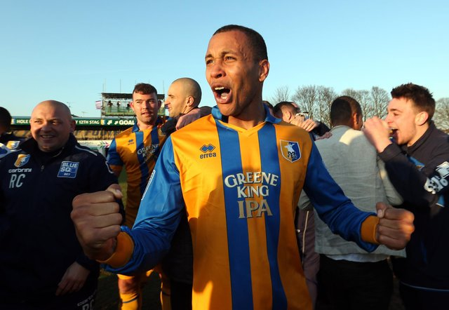 Matt Green celebrates Mansfield Town's promotion back to the EFL. (Photo by Ross Kinnaird/Getty Images)