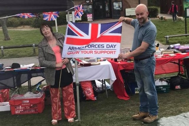 Eileen Massey, founder of Veterans Unite, and Coun Scott Carlton, fly the flag at Sunday's event for Armed Forces Day, which is to be held in June.