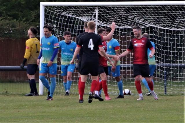 Ollerton celebrate after Brandon Shaw's goal. Pic by Nigel Owen.