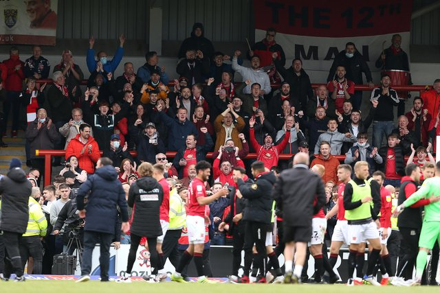Morecambe fans celebrate their side's play-off semi-final victory overTranmere Rovers.