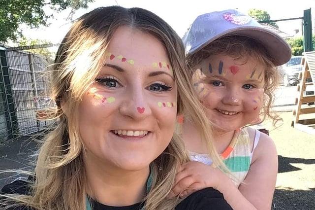 Tia Garrity, Cherubs Edwinstowe day nursery co-ordinator, enjoying festival fun with Rianne Moore, aged four.