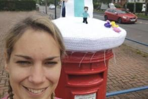 Vicki Picton with the post box topper in Rainworth.