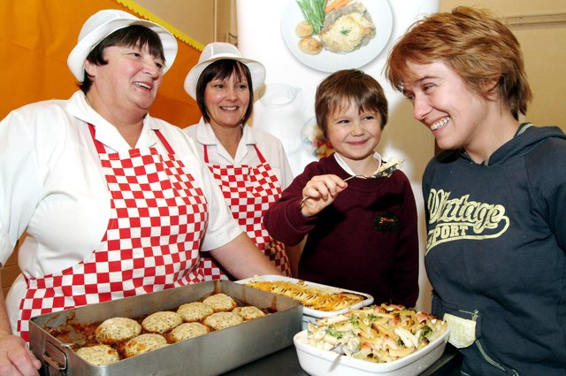 Six-year-old Erin Baranski  gets her mum Claire Baranski  to try out school dinners at The Birklands school open  activities evening for parents in 2006 also on pic are Dining room Assistants  Sheila Gilbert and Christine Sweeting