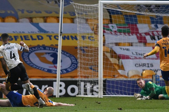Joss Labadie's shot goes under the dive of Aidan Stone to gift Newport the lead last Friday.