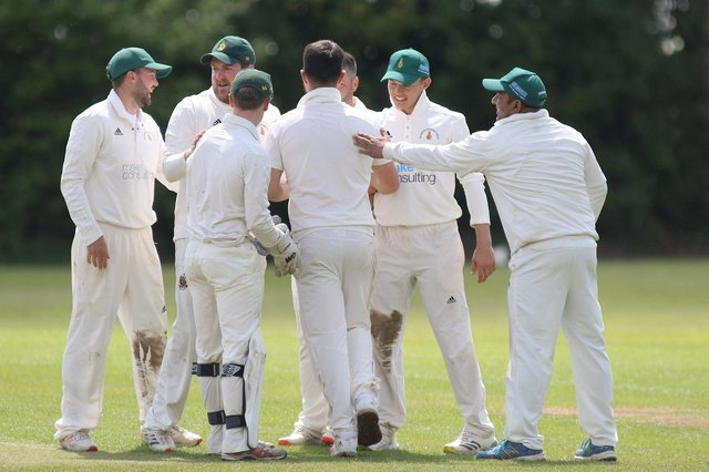 Hosiery Mills' bowler Daniel Harris is congratulated after taking two wickets in two balls in defeat at Papplewick on Saturday.