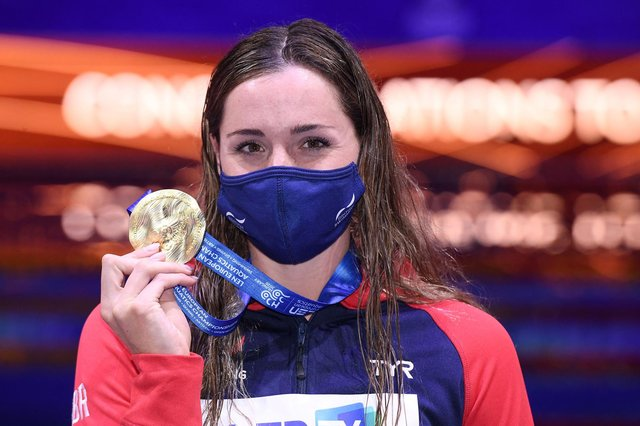 Wearing a mask on the podium can't hide Molly Renshaw's delight at European gold.