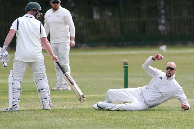 Dan Kilvington fields off his own bowling for Hosiery Mills