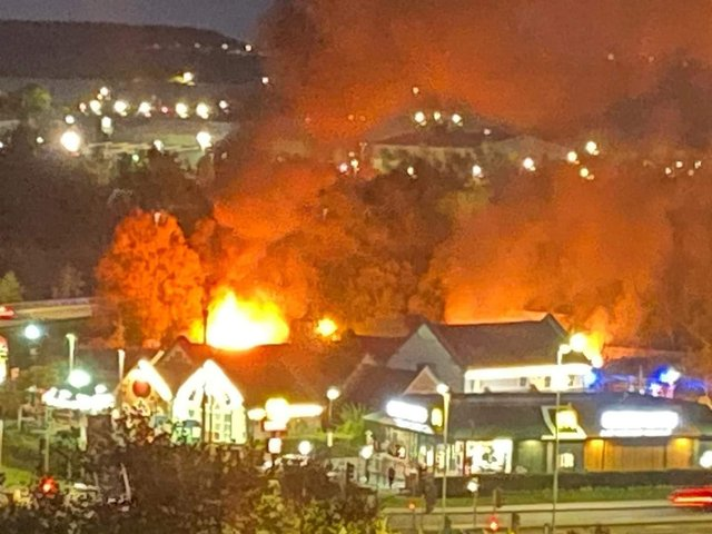 Flames light up the night sky behind the King's Mill Farm pub in Sutton this evening. Photo: Simona Sprowell