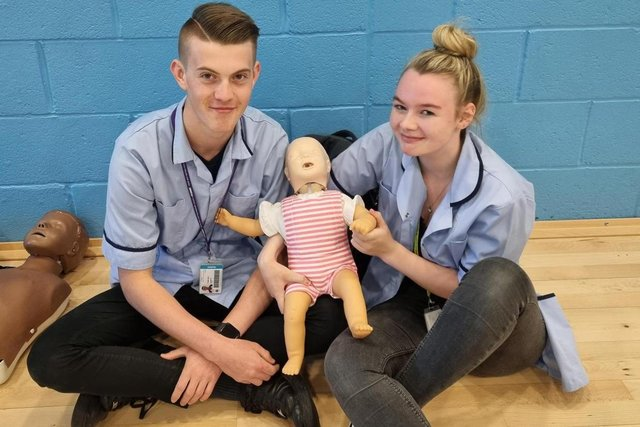 Health and social care students Freddie Diver and Bree Jenkinson were able to practice child CPR