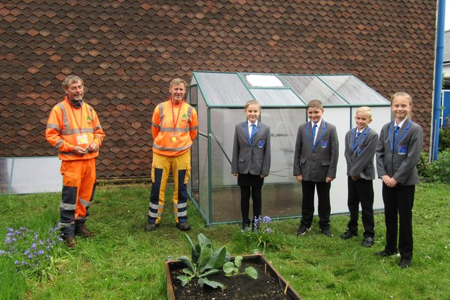 Steve and Steve from NSDC's Street Scene team, with Parkgate pupils in front of the new greenhouse