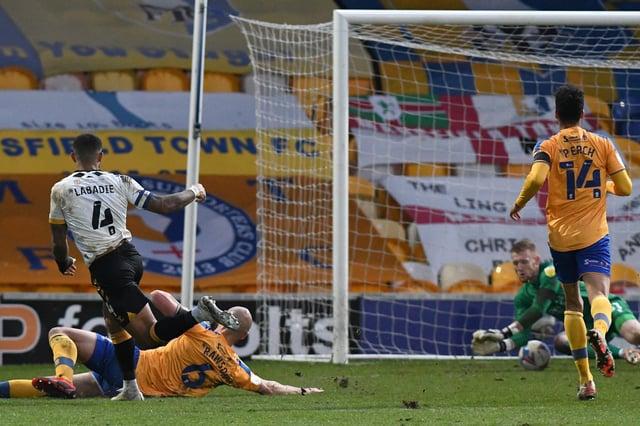 Newport's Joss Labadie scores the opening goal to punish Mansfield errors.