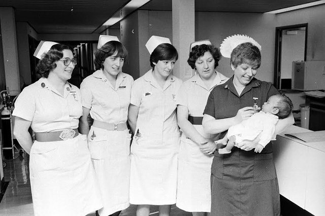 Nurses at Kings Mill Hospital in 1980 holding a new arrival