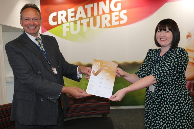 Claire received her certificate from principal Andrew Cropley