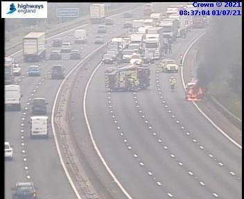 This picture from Highways England shows firefighters at the scene of the blaze.