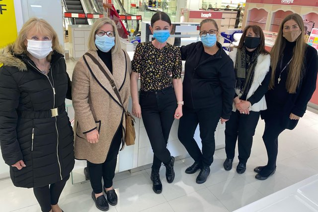 Long-serving employees Julie Howe (second right) and Glenis Thompson (second left) with other members of the cosmetics team at Mansfield's Debenhams store.