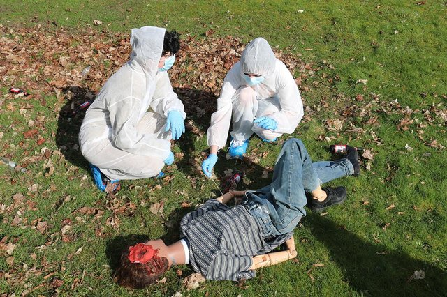 Students applied their classroom theory of forensics to the mock crime scene