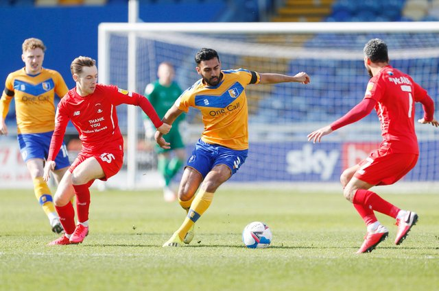 Mansfield Town's Malvind Benning (C) in action with Leyton Orient's Dan Kemp (L) and Leyton Orient's Jobi McAnuff. Picture: Craig Brough/AHPIX LTD